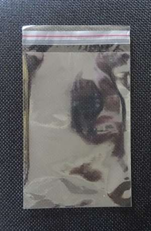 embalagem plastica com adesivo